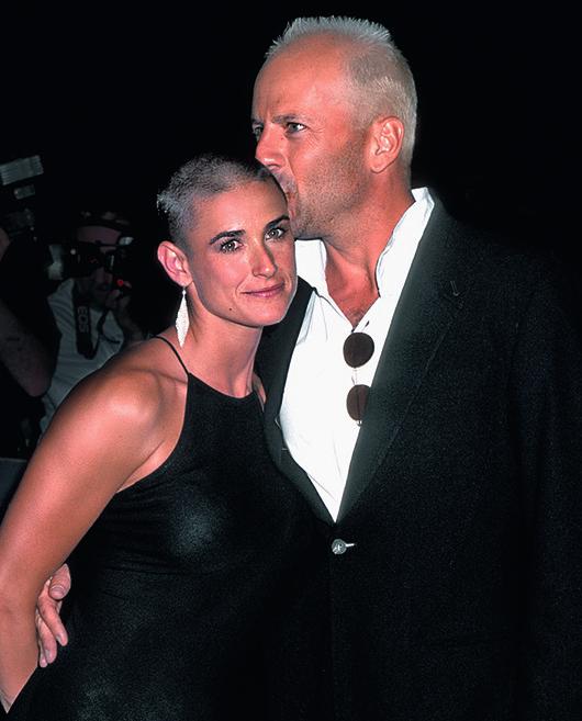 Деми Мур и Брюс Уиллис на премьере фильма «Стриптиз», 1996
